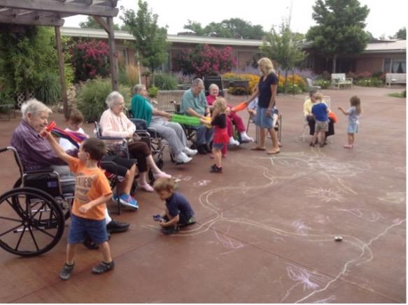 Regular intergenerational playtime in the courtyard at Schowalter Villa.