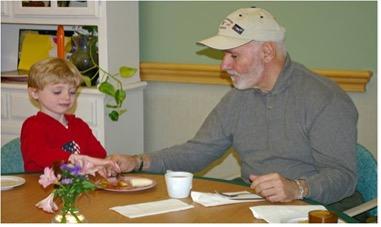 Children and older adults often eat breakfast together at Mount Kisco Child Care Center.