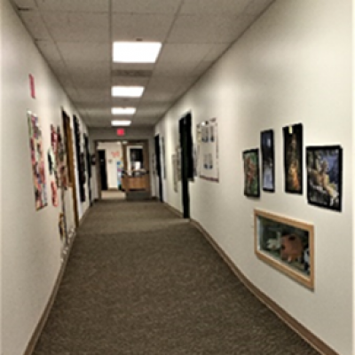 Hall way at Hesston Child Development Center showcasing art.